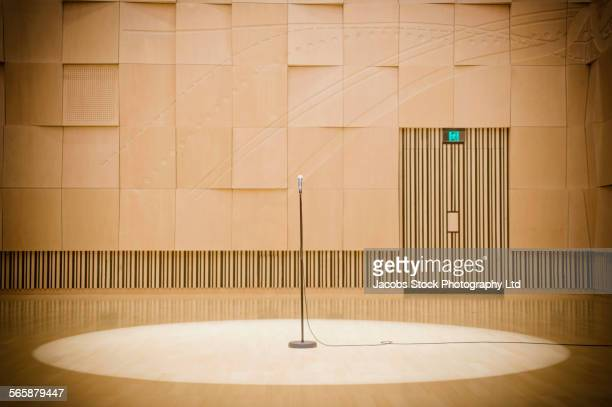 microphone in spotlight on stage - microphone stand stock photos and pictures