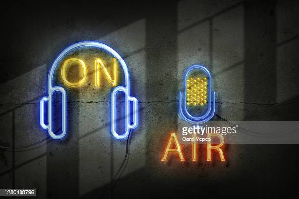 microphone in the old studio with on air sign in neon lights - recording studio stock pictures, royalty-free photos & images