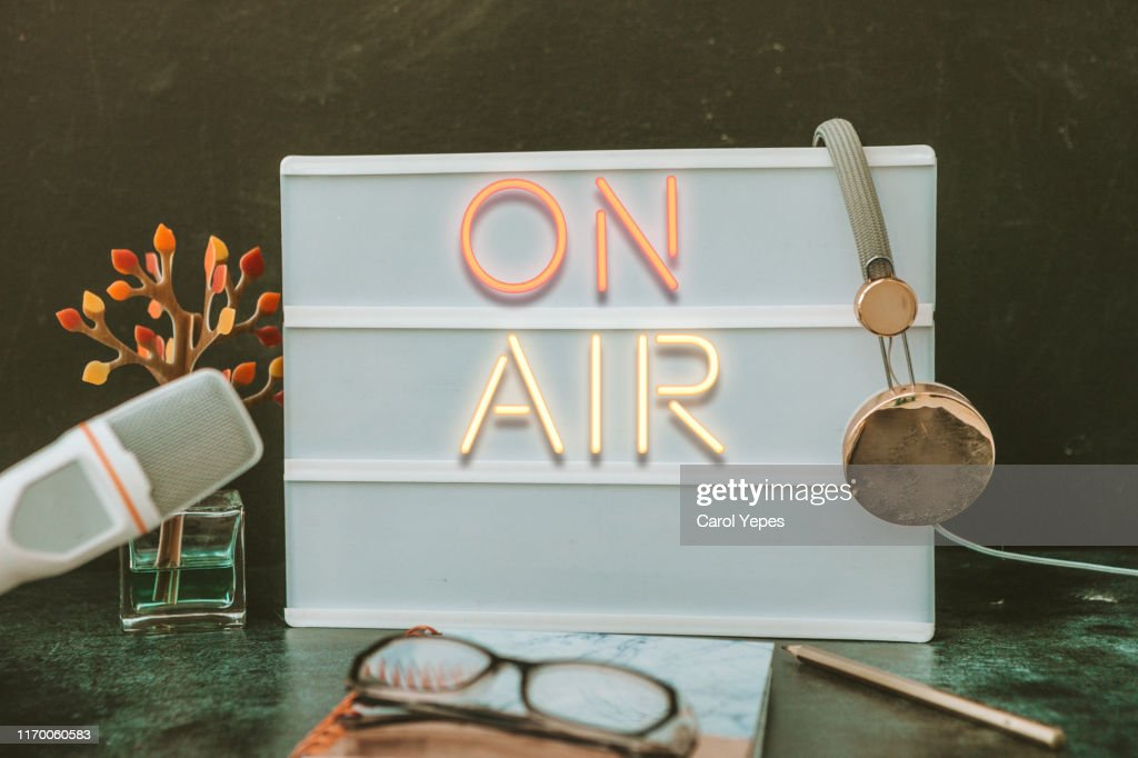Microphone in the old studio with on air sign : Stock Photo