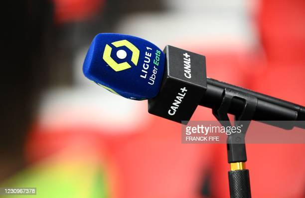 Microphone of the French TV channel Canal Plus is pictured during the French L1 football match between Paris Saint-Germain and Nimes Olympique at the...