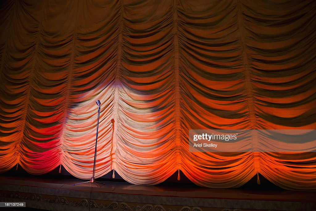 Microphone on empty theater stage : Stock Photo