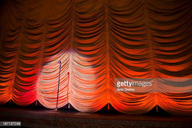 microphone on empty theater stage - spotlight film stock photos and pictures