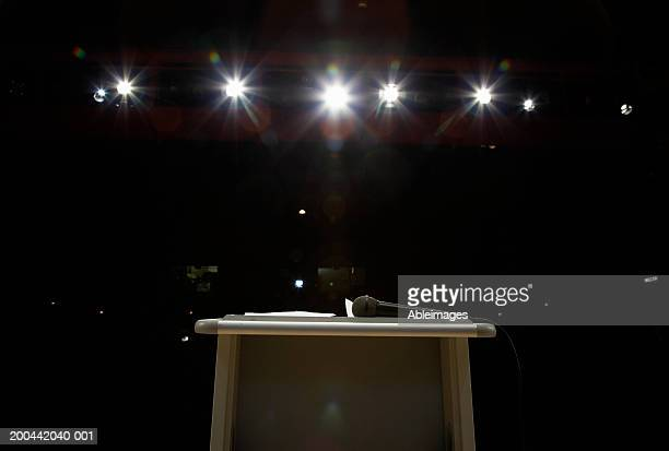 Microphone on lectern in illuminated auditorium