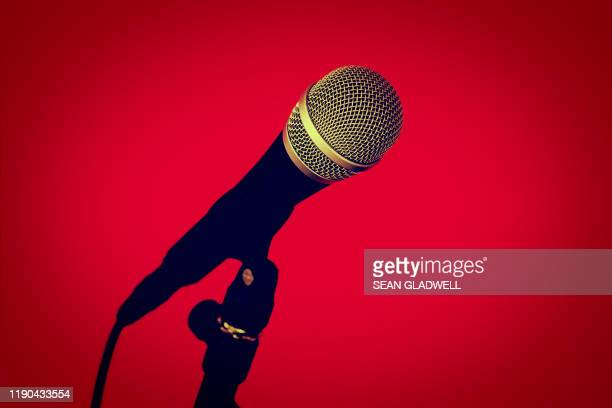 microphone on stand on red - pop music stock pictures, royalty-free photos & images
