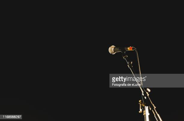 a microphone ready for speak - floodlit stock pictures, royalty-free photos & images