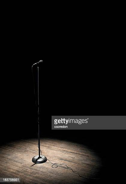 microphone under spotlight - spotlight stock photos and pictures