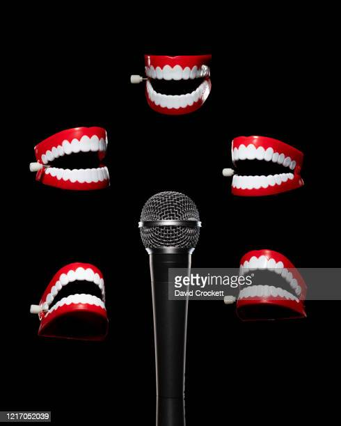 microphone with chattering teeth - comedian stock pictures, royalty-free photos & images