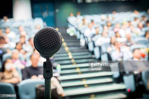 microphone with crowd - press conference stock pictures, royalty-free photos & images