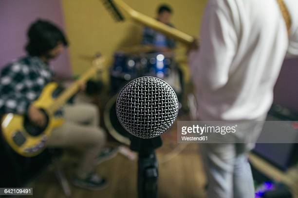 Microphone with music band rehearsing in background