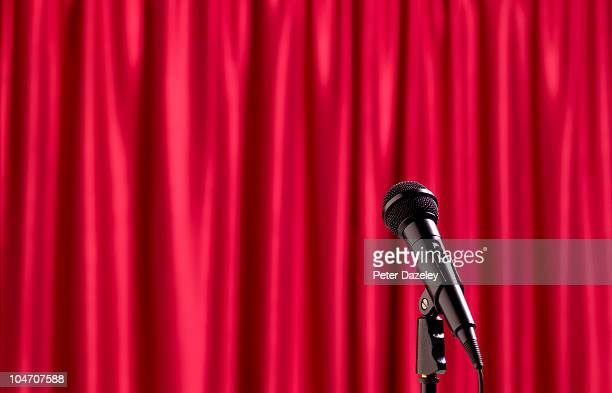 Microphone with red theatre curtain