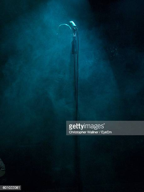 microphone with smoke during music concert - microphone stand stock photos and pictures