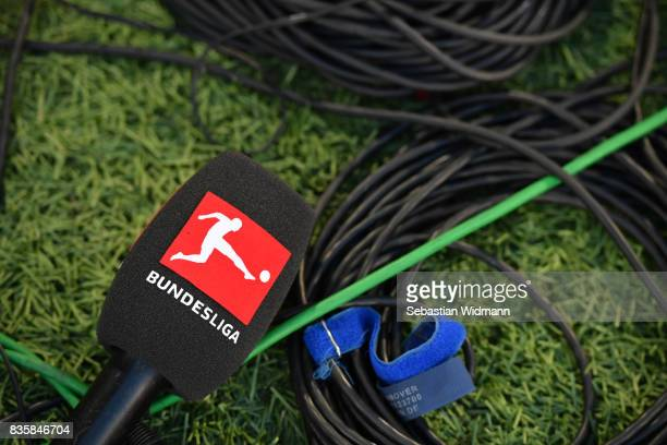 A microphone with the Bundesliga logo lies on the ground before the Bundesliga match between FC Bayern Muenchen and Bayer 04 Leverkusen at Allianz...