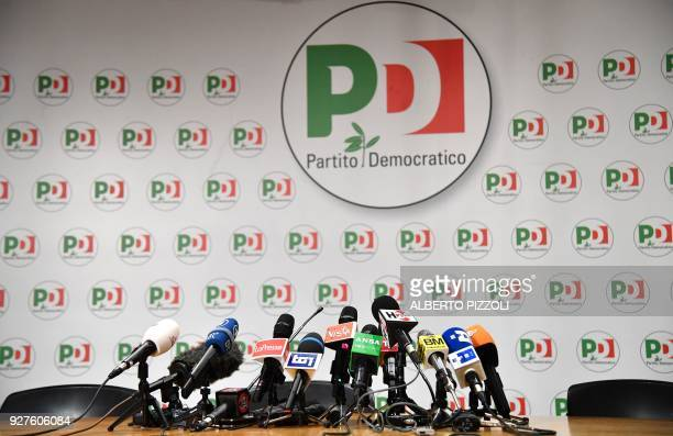 Microphones are set on a table before a press conference of former Prime Minister and leader of the Democratic Party Matteo Renzi a day after Italy's...