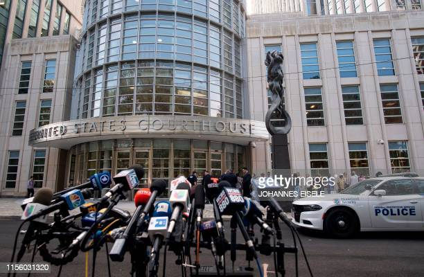 Microphones are set up outside Brooklyn Federal Court on July 17 for Mexican drug lord Joaquin El Chapo Guzman's sentencing in New York After a...