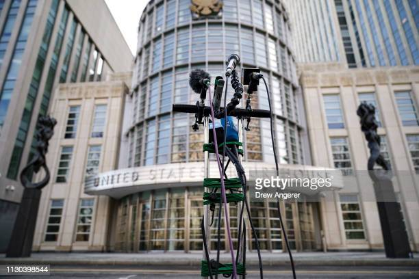 Microphones are set up outside US District Court for the Eastern District of New York March 14 2019 in the Brooklyn borough of New York City Huawei...