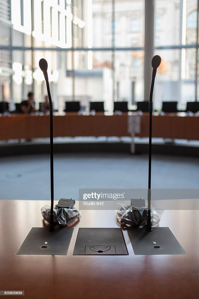 Microphones at desk in meeting room : Stock Photo
