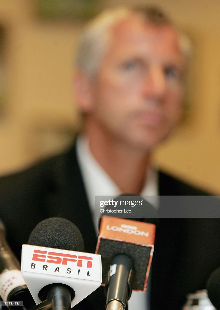 Microphones from Brazilian and English TV capture the voice of West Ham manager Alan Pardew during a West Ham United press conference to unveil their new signings at Upton Park on September 5, 2006 in London, England.