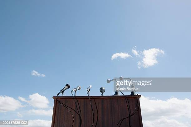 Microphones on lectern, outdoors, low angle view