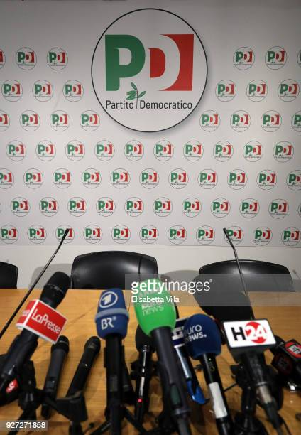 Microphones sit ahead of a press conference at the Democratic Party headquarters on March 5 2018 in Rome Italy The economy and immigration are key...