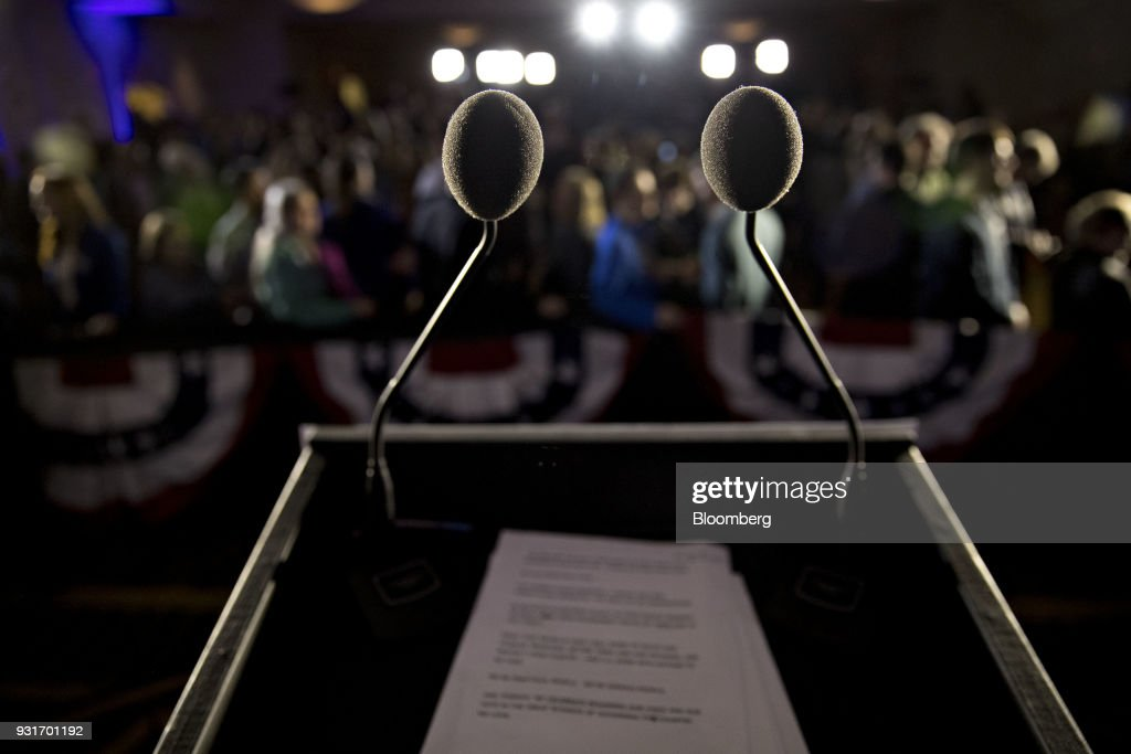 Microphones stand on a podium during an election night rally with Conor Lamb, Democratic candidate for the U.S. House of Representatives, not pictured, in Canonsburg, Pennsylvania, U.S., on Wednesday, March 14, 2018. Lamb and Republican Rick Saccone were locked in a tight contest for a House seat in Pennsylvania that may be a bellwether for the fall elections that will decide control of Congress. Photographer: Andrew Harrer/Bloomberg via Getty Images
