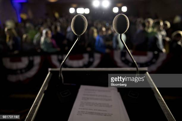 Microphones stand on a podium during an election night rally with Conor Lamb Democratic candidate for the US House of Representatives not pictured in...