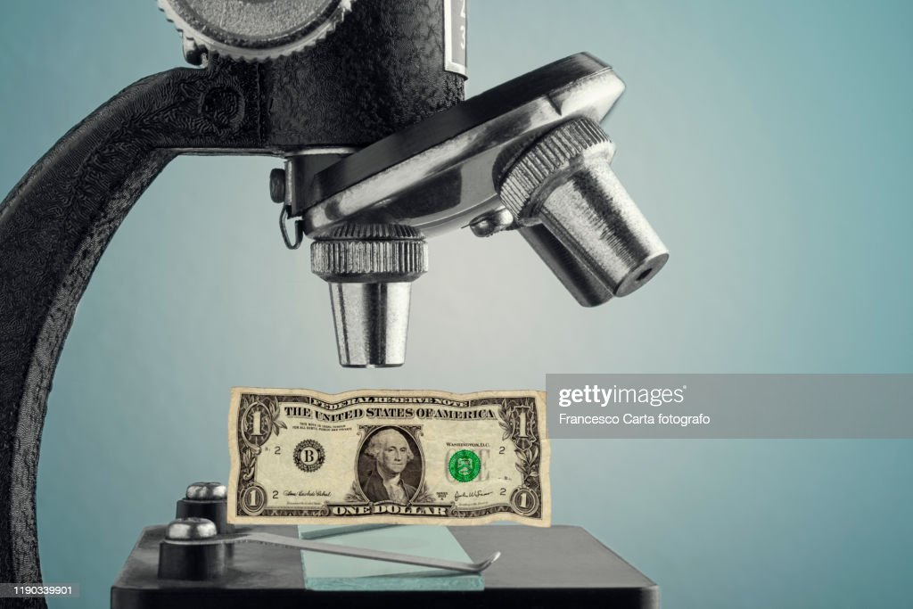 Microscope with One Dollar : Stock Photo