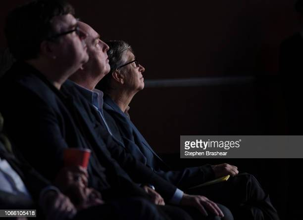 Microsoft board members including Bill Gates far right watch a video during the Microsoft Annual Shareholders Meeting at the Meydenbauer Center on...