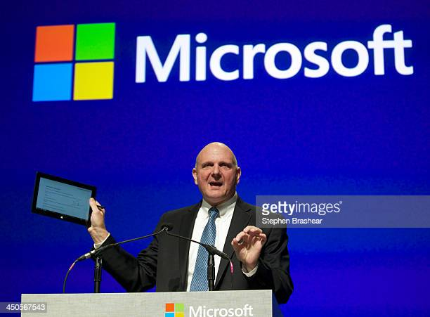 Microsoft CEO Steve Ballmer addresses shareholders while holding up a tablet during the Microsoft Shareholders Annual Meeting November 19 2013 in...