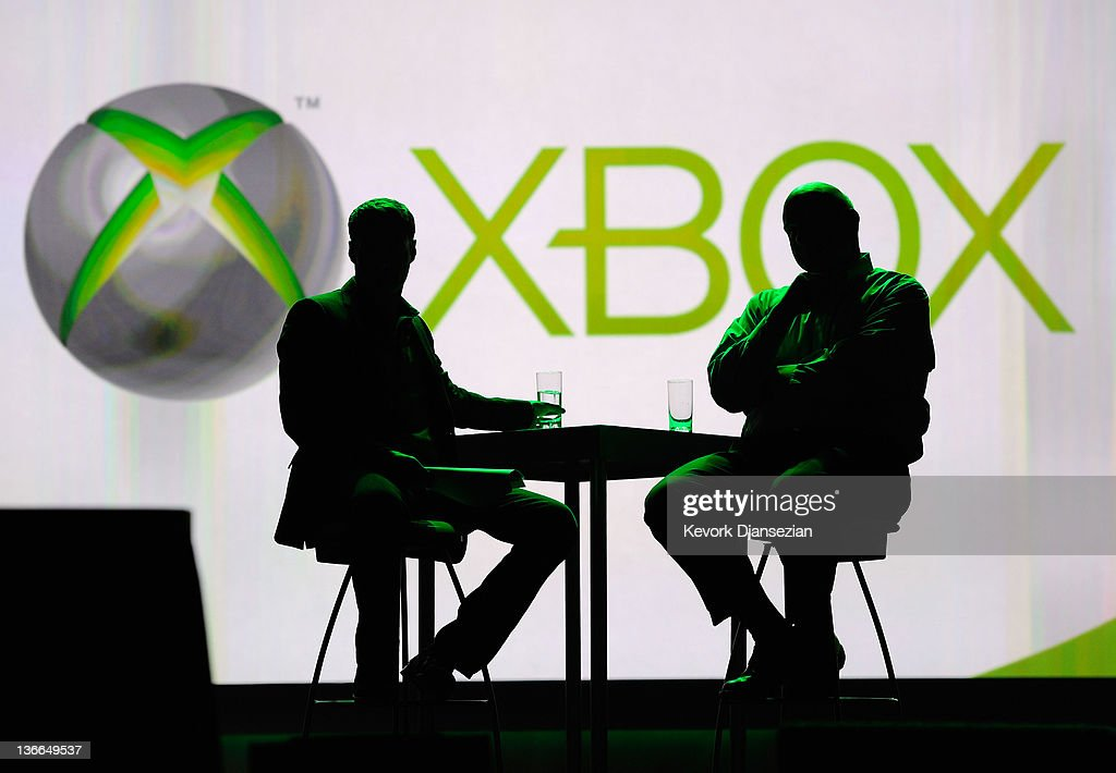 Microsoft CEO Steve Ballmer (R) and host Ryan Seacrest watch an Xbox presentation during Ballmer's keynote address at the 2012 International Consumer Electronics Show at The Venetian January 09, 2012 in Las Vegas, Nevada. CES, the world's largest annual consumer technology trade show, runs through January 13 and is expected to feature 2,700 exhibitors showing off their latest products and services to about 140,000 attendees.