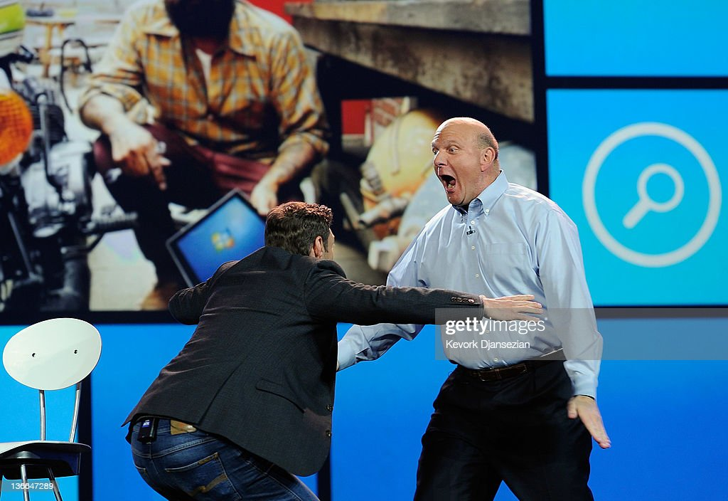 Microsoft CEO Steve Ballmer hugs host Ryan Seacrest before his keynote address at the 2012 International Consumer Electronics Show at The Venetian January 9, 2012 in Las Vegas, Nevada. CES, the world's largest annual consumer technology trade show, runs through January 13 and is expected to feature 2,700 exhibitors showing off their latest products and services to about 140,000 attendees.