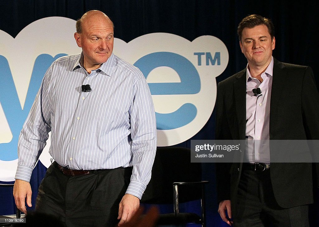 Microsoft CEO Steve Ballmer (L) looks over his shoulder at Skype CEO Tony Bates during a news conference on May 10, 2011 in San Francisco, California. Microsoft has agreed to buy Skype for $8.5 billion.