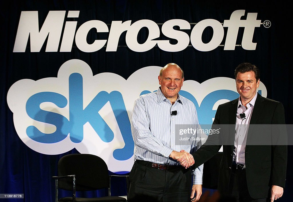 Microsoft CEO Steve Ballmer (L) shakes hands with Skype CEO Tony Bates during a news conference on May 10, 2011 in San Francisco, California. Microsoft has agreed to buy Skype for $8.5 billion.