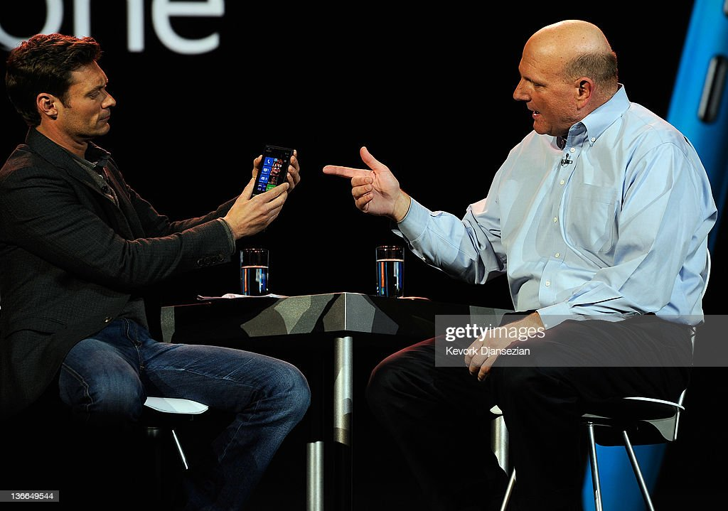 Microsoft CEO Steve Ballmer (L) shows the new Nokia Lumia 900 Windows phone to h0st Ryan Seacrest as he delivers a keynote address at the 2012 International Consumer Electronics Show at The Venetian January 09, 2012 in Las Vegas, Nevada. CES, the world's largest annual consumer technology trade show, runs through January 13 and is expected to feature 2,700 exhibitors showing off their latest products and services to about 140,000 attendees.