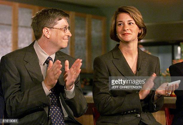Microsoft Chairman and CEO Bill Gates looks at his wife Melinda 16 September 1999 during a press conference in Seattle where they announced the...