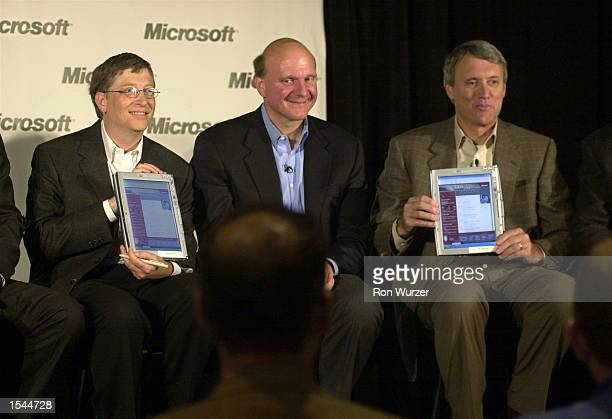 Microsoft Chairman and Chief Software Architect Bill Gates and Chairman and CEO for Toys R Us John Eyler hold up the Tablet PC which runs on Windows...