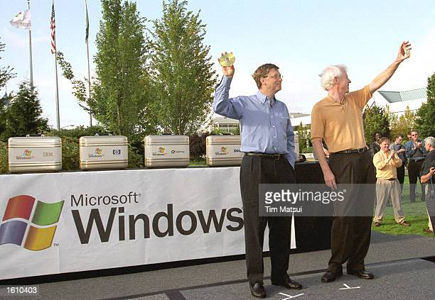 Microsoft Chairman and chief software architect Bill Gates and Platforms Group Vice President Jim Allchin hold up CDs during the release of the...