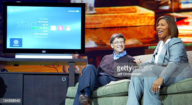 Microsoft Chairman and Chief Software Architect Bill Gates is joined by actress and singer Queen Latifah as he demonstrates the Microsoft Windows XP...