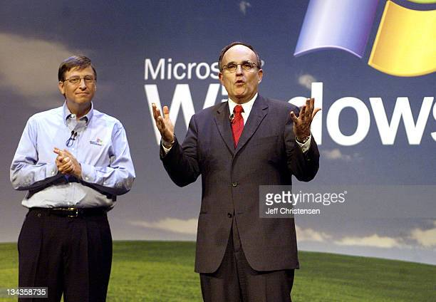 Microsoft Chairman and chief software architect Bill Gates listens to New York Mayor Rudolph Giuliani at the Microsoft XP launch in New York October...