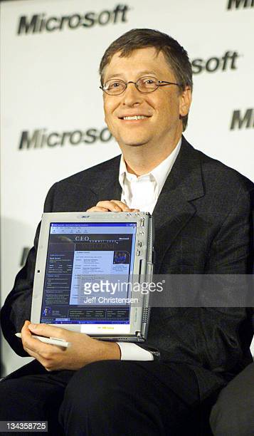 Microsoft Chairman and Chief Software Architect Bill Gates shows reporters the new Tablet PC during a news conference at the sixth annual CEO summit...