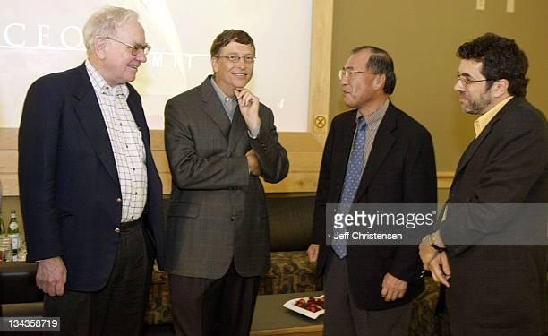 Microsoft chairman and chief software architect Bill Gates talks to Warren Buffett Chairman, Berkshire Hathaway Inc., Atsutoshi Nishida, Executive...