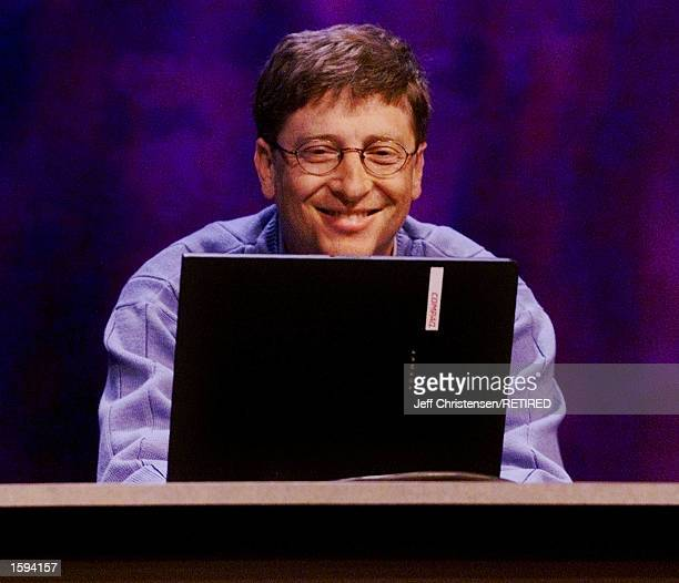 Microsoft chairman and chief software architect Bill Gates works on a laptop as he talks to members of the media about Windows XP the new Windows...