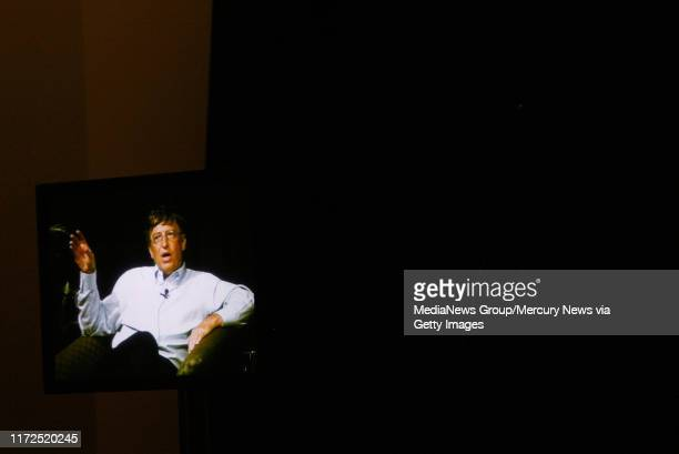 Microsoft chairman and chief technology architect Bill Gates is seen on a TV as he speaks at an event where Gates discussed about future of...