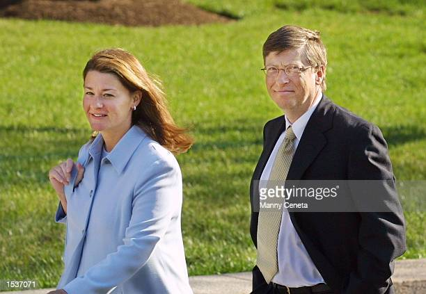 Microsoft Chairman Bill Gates and his wife Melinda arrive at the Federal Courthouse April 23 2002 in Washington DC Gates will take the stand for...