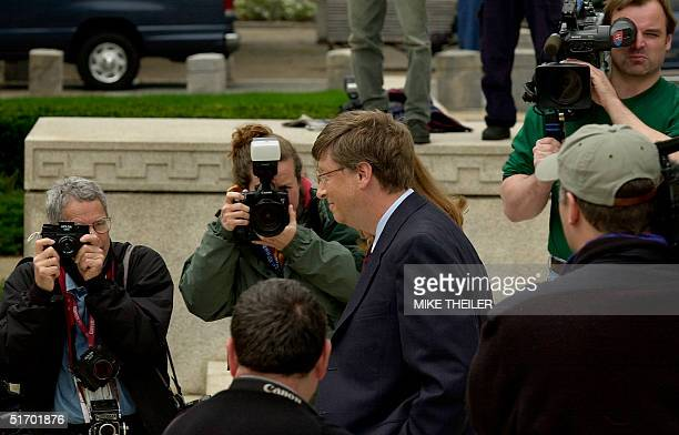 Microsoft Chairman Bill Gates and his wife Melinda walk to make a statement to the press prior to Gates' appearance at US Courthouse to testify in...
