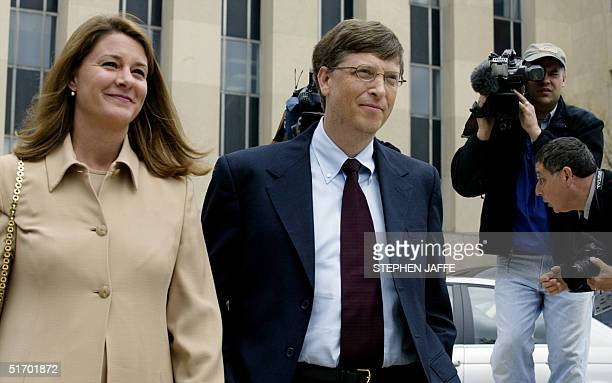 Microsoft Chairman Bill Gates arrives 22 April 2002 with his wife Melinda at the US District Courthouse in Washington, DC for a rare court appearance...