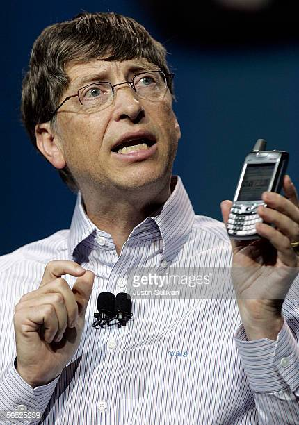 Microsoft Chairman Bill Gates holds a new Palm Treo 700w Smartphone with Verizon service as he delivers the opening keynote address at the 2006...