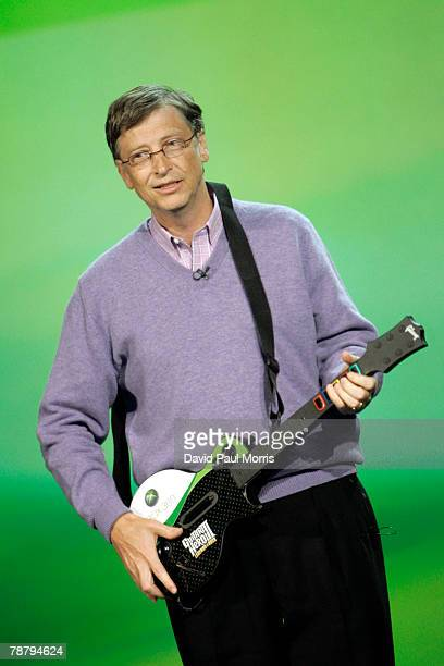 Microsoft chairman Bill Gates plays an XBOX 360 guitar during the opening keynote address at the 2008 International Consumer Electronics Show at the...