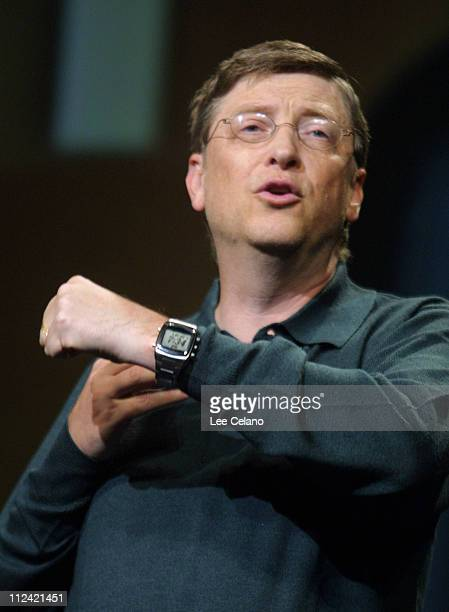 Microsoft chairman Bill Gates shows a Smart Personal Object Technology watch by Fossil Wednesday Jan 8 during his keynote address for the Consumer...