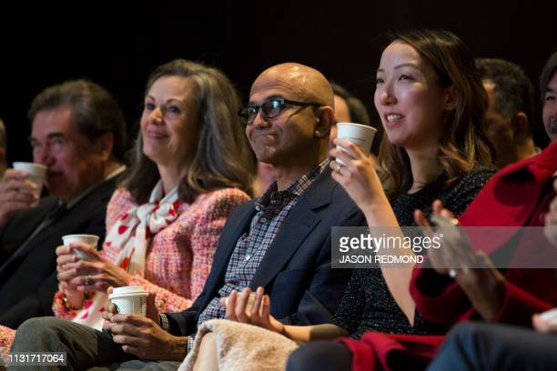 Microsoft Chief Executive Officer Satya Nadella drinks coffee with other Starbucks Board of Directors members at the Annual Meeting of Shareholders...