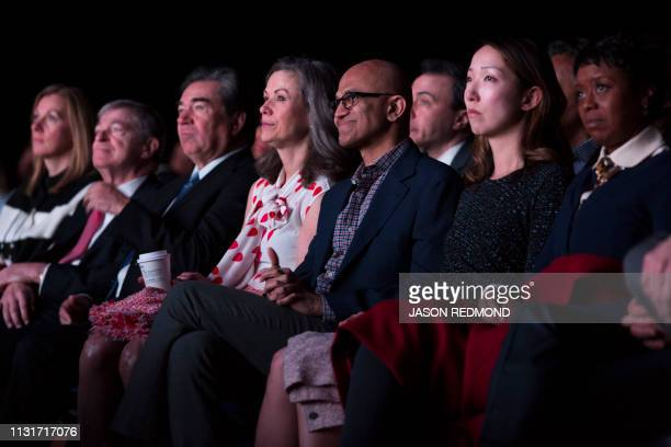 Microsoft Chief Executive Officer Satya Nadella sits with other Starbucks Board of Directors members at the Annual Meeting of Shareholders in Seattle...